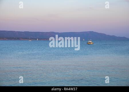Alghero, Sardinia / Italy - 2018/08/11: Panoramic view of the Gulf of Alghero and town of Fertilia in the Porto Conte Regional Park - Stock Photo