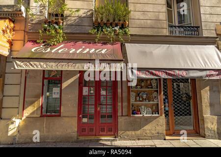 Esterina glaces and sorbet shop and Il Campiello a decorative mask shop on  Rue Saint-Louis en l'Île ,Île Saint-Louis,Paris - Stock Photo