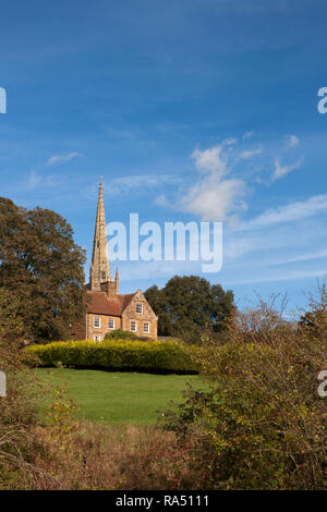 The spire of All Saints' Church and the Manor House, Braunston, Northampton, England, UK - Stock Photo
