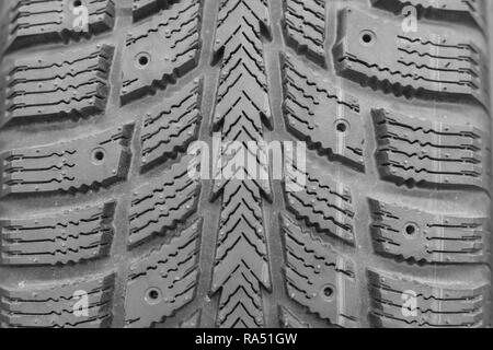 Close-up winter tire tread. Textured tire tread. Part of brand new modern winter car tire - Stock Photo