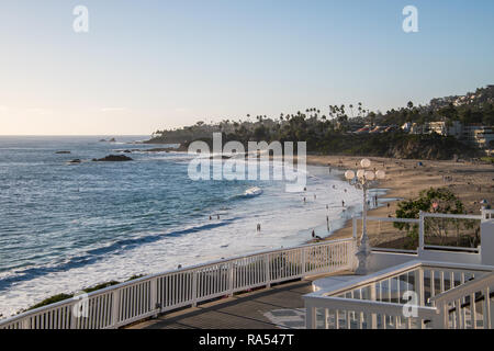 Laguna Beach, California - October 9, 2018: View from above Laguna Beach, California showing people in the water, on the beach and walking along the s - Stock Photo