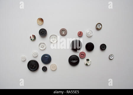 Collection of various buttons isolated on white background from a high angle view - Stock Photo