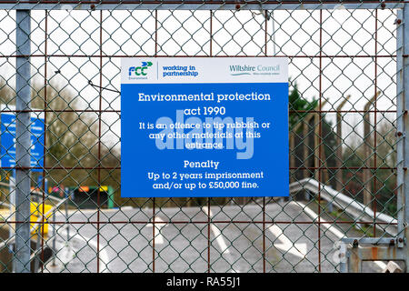 Environmental protection act 1990 sign on the gate at the entrance to a recycling centre - Stock Photo