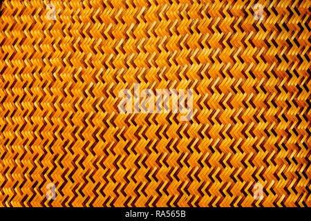 Close-up of the brown thin bamboo weave is a zig-zag pattern from Thai artisans on handmade in thai art style, Pattern and texture background - Stock Photo