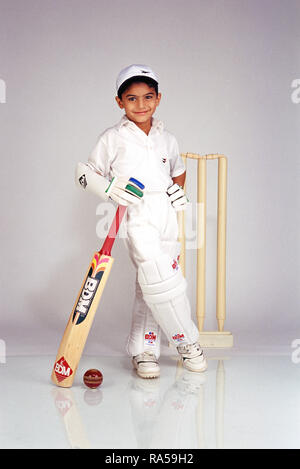 YOUNG BOY CRICKETER DRESSED IN CRICKET GEAR - Stock Photo