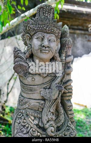 Traditional Bali island stone sculpture of man - Stock Photo