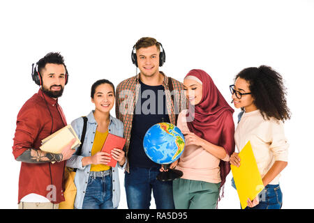 muslim woman holding globe and standing with multicultural group of people isolated on white - Stock Photo