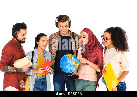 cheerful muslim woman holding globe and standing with multicultural group of people isolated on white - Stock Photo