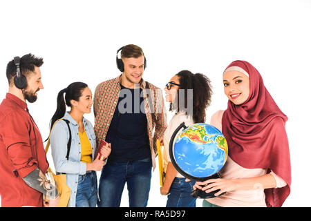 beautiful muslim woman standing with globe near multiethnic group of people isolated on white - Stock Photo