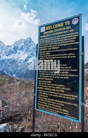 Sign welcoming trekkers to the Annapurna Conservation Area in Nepal - Stock Photo
