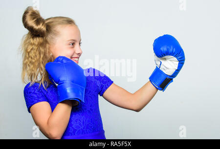 Sport and sportswear fashion. training with coach. Fight. Boxer child workout, healthy fitness. knockout and energy. Sport success. little girl in boxing gloves punching. Born to fight. - Stock Photo