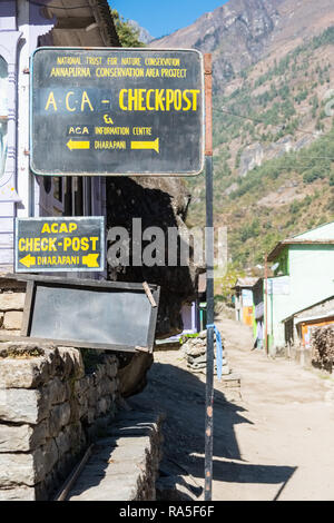 Annapurna Conservation Area checkpoint on the Annapurna Circuit trek at Dharapani, Nepal - Stock Photo