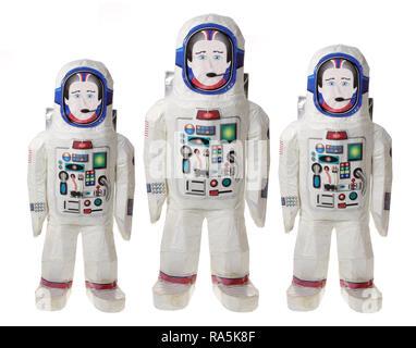 Spacemen Toys on White Background - Stock Photo