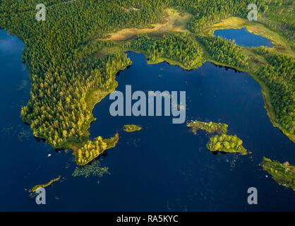 Drone shot, boreal, arctic conifers in wetland at the lake with small islands, Jävre, Norrbottens län, Sweden - Stock Photo