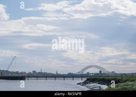View of the Silver Jubilee Bridge spanning the River Mersey between Widnes and Runcorn - Stock Photo