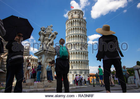 Pisa, Italy - May, 17, 2017: Tourist looking up and admiring the Leaning Tower of Pisa. - Stock Photo