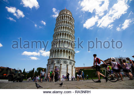 Pisa, Italy - May, 17, 2017: Tourist taking photos around the bottom of the leaning tower of Pisa. - Stock Photo
