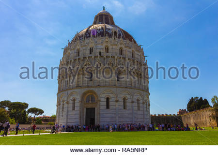 Pisa, Italy - May, 17, 2017: Tourist quing at the bottom of the Pisa Baptistery waiting to enter. - Stock Photo
