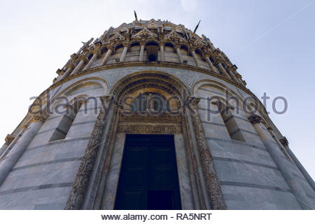 Pisa, Italy - May, 17, 2017: Close up shot of the amazing detail of the Pisa Baptistery. - Stock Photo