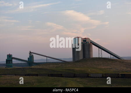Coal train, coal mining silos, and processing operations in the Powder River Basin of Wyoming / USA. - Stock Photo
