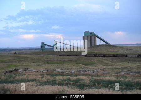 Coal train, coal mining silos, and processing operations in the Powder River Basin of Wyoming, USA. - Stock Photo
