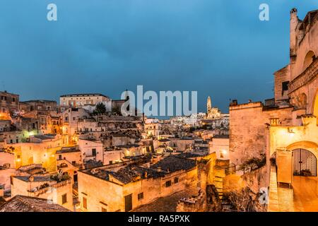 Sasso Caveoso and Cathedral Maria Santissima della Bruna, blue hour, Matera, Basilicata, Italy - Stock Photo