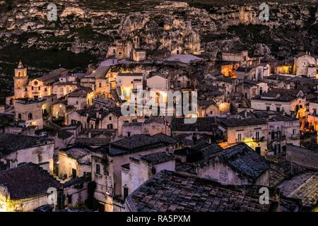 Sasso Caveoso district with San Pietro Caveoso church and Santa Maria de Idris cave church at night, Matera, Basilicata, Italy - Stock Photo