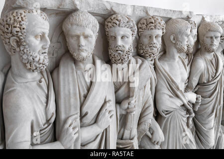 A Roman sarcophagus of the   3rd cen. AD, depicting men in traditional Roman dress, the toga,  In the National Archaeological Museum at Naples, Italy. - Stock Photo