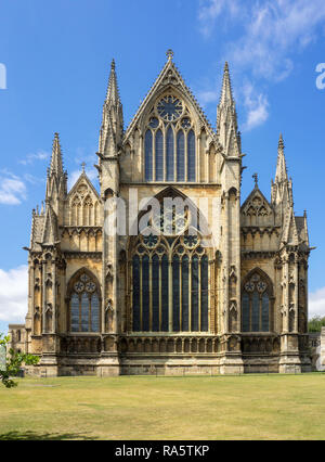 Gothic cathedral in Lincoln, Lincolnshire, England, UK. Presbytery with rosettes and lancet windows with stained glass - Stock Photo
