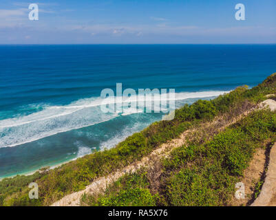 Top aerial view of beauty Bali beach. Empty paradise beach, blue sea waves in Bali island, Indonesia. Suluban and Nyang Nyang place - Stock Photo