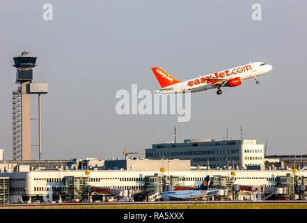 EasyJet Airbus A319 taking off at Duesseldorf International Airport, Air Traffic Control Tower, Duesseldorf - Stock Photo