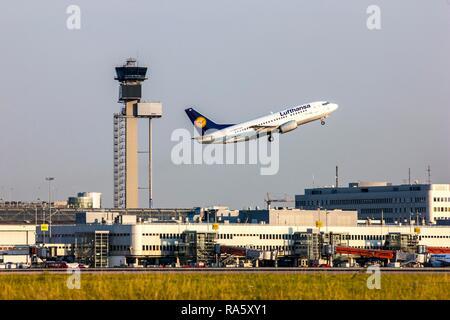 Lufthansa Boeing 737, taking off at Duesseldorf International Airport, flight control tower, Duesseldorf, North Rhine-Westphalia - Stock Photo