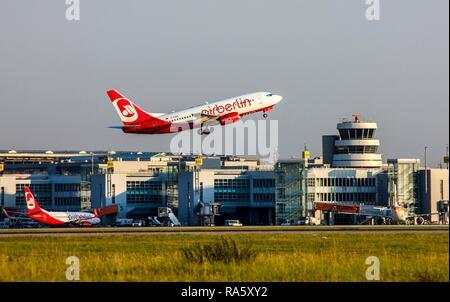 Air Berlin Boeing 737 taking off at Duesseldorf International Airport, flight control tower, Duesseldorf, North Rhine-Westphalia - Stock Photo