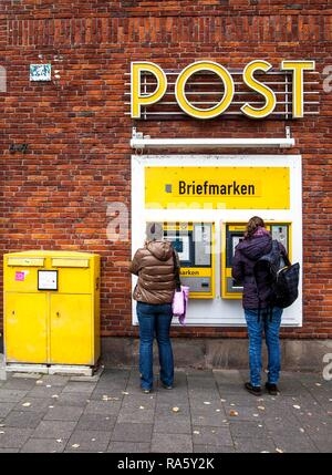 Stamp machines, mail box of the German Mail at a post office, Domplatz, Muenster, North Rhine-Westphalia - Stock Photo