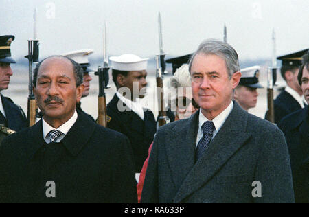 1978 - Egyptian President Anwar el-Sadat (left) receives military honors upon his arrival in the United States.  He is accompanied by US Secretary of State Cyrus R. Vance (right). - Stock Photo