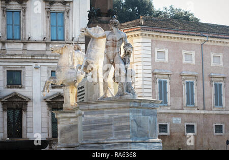 Rome, Italy - December 28, 2018: Obelisk and Fountain of Castor and Pollux in Piazza del Quirinale - Stock Photo