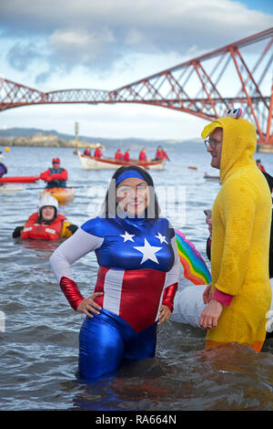 South Queensferry, Edinburgh, Scotland UK. 01 January 2019. Queensferry New Year Loony Dook, the annual dip in the Firth of Forth in the shadow of the world-famous Forth Rail Bridge. Takes place on the third day of the Edinburgh Hogmany New Year celebrations. Maximum capacity crowd - Stock Photo