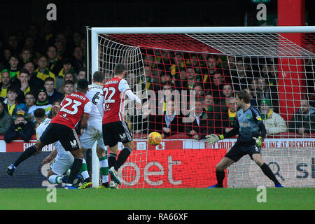 London, UK. 1st Jan, 2018. Julian Jeanvier of Brentford (23) scores his team's first goal. EFL Skybet championship match, Brentford v Norwich City at Griffin Park on New Years Day, Tuesday 1st January 2019 . this image may only be used for Editorial purposes. Editorial use only, license required for commercial use. No use in betting, games or a single club/league/player publications. pic by Steffan Bowen/Andrew Orchard sports photography/Alamy Live news Credit: Andrew Orchard sports photography/Alamy Live News - Stock Photo