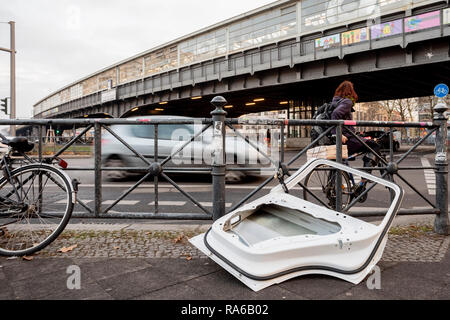 Berlin, Germany. 18th Dec, 2018. A car door is locked to a railing at the Kottbusser Tor. In Berlin, the name of a well-known place is reminiscent of a Brandenburg city, but it is written differently. (to dpa-KORR 'C or K? What the Kottbusser gate has to do with Cottbus' from 02.01.2019) Credit: Christoph Soeder/dpa/Alamy Live News - Stock Photo