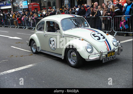 A Beetle vintage vehicle takes part in a parade during London's New Year's Day parade. Bands dancers, cars, bikes and around 8,000 performers took part. - Stock Photo