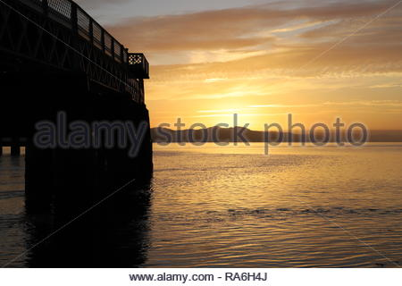 Dundee, Scotland, UK. 2nd January 2019. Sunset over Tay Rail Bridge, glorious end to a sunny day in Tayside.  Credit: Stephen Finn/Alamy Live News - Stock Photo