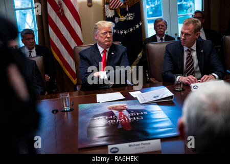 U.S. President Donald Trump listens beside Patrick Shanahan, acting U.S. secretary of defense, right, during a cabinet meeting in the Cabinet Room of the White House, on Wednesday, Jan. 2, 2019 in Washington, D.C.  Credit: Al Drago / Pool via CNP | usage worldwide - Stock Photo