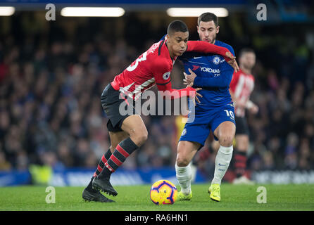 London, UK. 02nd Jan, 2019. Yan Valery of Southampton & Eden HAZARD of Chelsea during the Premier League match between Chelsea and Southampton at Stamford Bridge, London, England on 2 January 2019. Photo by Andy Rowland. Credit: Andrew Rowland/Alamy Live News - Stock Photo
