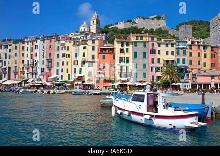 Colorful row of houses at the port of Portovenere, province La Spezia, Riviera di Levante, Liguria, Italy - Stock Photo