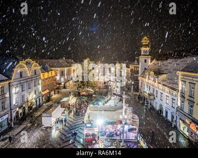 Snowfall at the Christmas market, main square of Leoben, Styria, Austria - Stock Photo