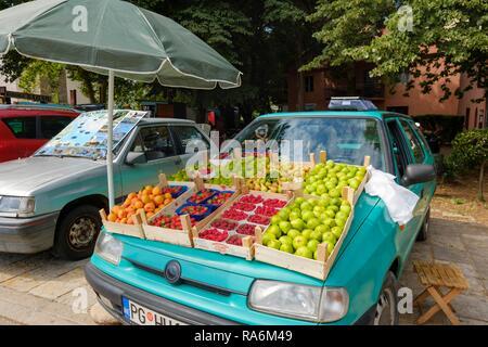 Display of fruit on hood of car, Virpazar, at Lake Skadar, at bar, Montenegro - Stock Photo