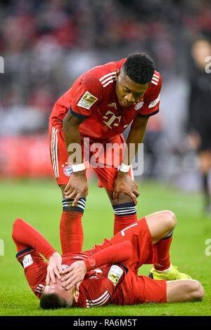 Franck Ribery FC Bayern Munich injured on ground, David Alaba FC Bayern Munich worried, Allianz Arena, Munich, Bavaria, Germany - Stock Photo