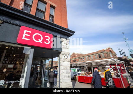 OTTAWA, CANADA - NOVEMBER 11, 2018: EQ3 logo in front of their local store in downtown Ottawa, Ontario. EQ3 is a Canadian chain of stores selling mode - Stock Photo