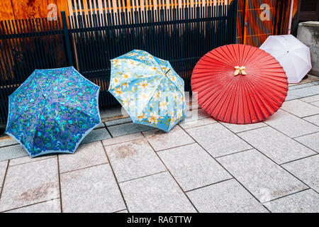 Colorful umbrellas at Gion Japanese traditional street in Kyoto, Japan - Stock Photo