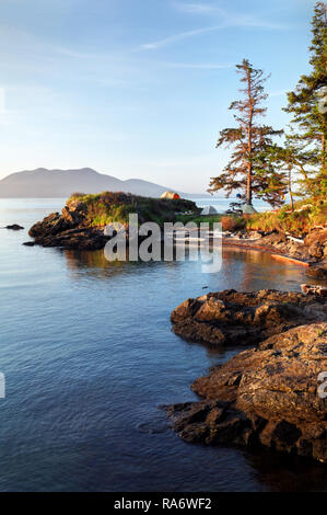 Sea kayakers camp on Doe Island, San Juan Islands, Washington State, USA - Stock Photo